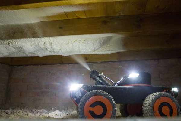 Robotic vehicle to insulate suspended timber floors